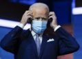 President-elect Joe Biden puts on his face mask after introducing nominees and appointees to key national security and foreign policy posts at The Queen theater, Tuesday, Nov. 24, 2020, in Wilmington, Del. (AP Photo/Carolyn Kaster)