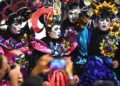(FILES) In this file photo taken on January 25, 2018 performers participate in the opening parade of the Uruguayan carnival -- the world's longest -- in Montevideo. - On January 24, 2019 Uruguay opens its carnival with a parade along the main avenue of Montevideo, on this electoral campaign year the Uruguayan carnival will be without doubt the popular scenario of political criticism. (Photo by MIGUEL ROJO / AFP)