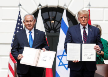 Israel's Prime Minister Benjamin Netanyahu stands with U.S. President Donald Trump after signing the Abraham Accords, normalizing relations between Israel and some of its Middle East neighbors,  in a strategic realignment of Middle Eastern countries against Iran, on the South Lawn of the White House in Washington, U.S., September 15, 2020. REUTERS/Tom Brenner