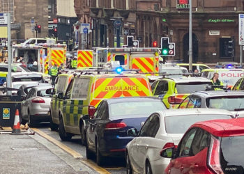 CORRECTS BYLINE - In this photo provided by Jamie O'Neill, emergency services attend the scene of incident in Glasgow, Scotland, Friday June 26, 2020. Police in Glasgow say emergency services are currently dealing with an incident in the center of Scotland's largest city and are urging people to avoid the area. ( @JATV_Scotland via AP)