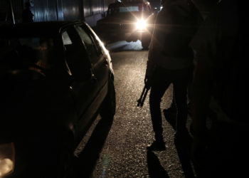 Members of the Special Action Force of the Venezuelan National Police (FAES) stand between passing cars during a night patrol, in Barquisimeto, Venezuela September 20, 2019. Picture taken September 20, 2019 REUTERS/Ivan Alvarado