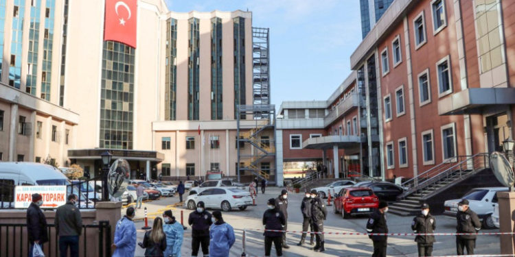 Police cordon off the area in front of the privately-run Sanko University Hospital in Gaziantep after nine patients, all infected with Covid-19, died in a fire on December 19, 2020. (Photo by Kadir Gunes / Demiroren News Agency (DHA) / AFP)