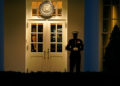 A Marine guard stands at the entrance to the West Wing of the White House, after the U.S. House impeached President Donald Trump in Washington, Wednesday, Jan. 13, 2021. The guard's presence signifies the president is in the Oval Office. (AP Photo/Gerald Herbert )