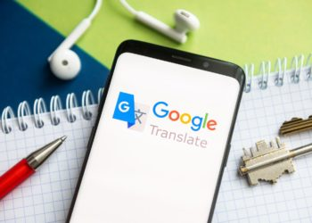 POLAND - 2021/02/09: In this photo illustration, a Google Translate logo seen displayed on a smartphone with a pen, key, book and headsets in the background. (Photo Illustration by Mateusz Slodkowski/SOPA Images/LightRocket via Getty Images)