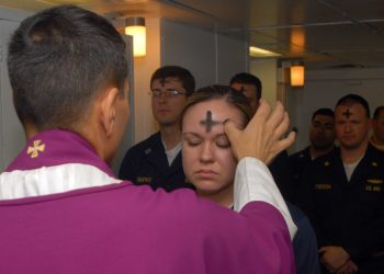080206-N-7869M Atlantic Ocean (February 6, 2008) - Electronics Technician 3rd Class Leila Tardieu receives the sacramental ashes during an Ash Wednesday celebration aboard the multi-purpose amphibious assault ship USS Wasp (LHD 1). Wasp is currently participating in a number of preparatory evolutions prior to entering a regularly-scheduled dry dock period. U.S. Navy photo by Mass Communication Specialist 3rd Class Brian May (RELEASED)