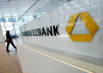 FILE PHOTO: A company logo is pictured at the headquarters of Germany's Commerzbank AG during the annual results news conference in Frankfurt, Germany, February 13, 2020.  REUTERS/Ralph Orlowski