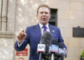 Andrew Giuliani, son of former New York Mayor Rudy Giuliani, speaks to reporters outside the building where his father lives, Wednesday, April 28, 2021, in New York. Federal agents raided Rudy Giuliani's Manhattan home and office on Wednesday, seizing computers and cellphones in a major escalation of the Justice Department's investigation into the business dealings of former President Donald Trump's personal lawyer. (AP Photo/Mary Altaffer)