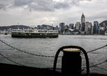 (FILES) In this file photo taken on July 15, 2021, a Star Ferry crosses Victoria Harbour in Hong Kong. - The US on July 16, 2021, warned its business community of growing risks of operating in Hong Kong following a clampdown by China in the major financial hub. In a long-awaited advisory that has already been denounced by China, US government agencies led by the State Department told entrepreneurs that they face particular risks from the imposition a year ago of a draconian new security law. (Photo by ISAAC LAWRENCE / AFP)
