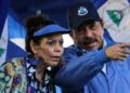 """Nicaraguan President Daniel Ortega (R) and his wife and Vice-President Rosario Murillo, speak during a rally in Managua, on September 5, 2018. - Ortega asked the US for respect and to """"do not mess with Nicaragua"""", hours after the UN Security Council, discussed the crisis in the Central American country, which has left more than 320 dead. (Photo by INTI OCON / AFP)"""
